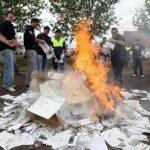 Men burn copies of the Murray-Darling draft plan in the NSW town of Griffith as anger mounts over the proposed cuts. Picture: Nathan Edwards