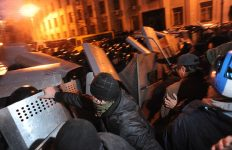 Riot police (Bekrut), defending the Kiev city council building, and protesters, Violent outcome of the clash at Bankova str, Kiev, Ukraine. December 1, 2013