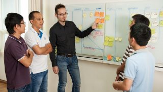 A daily Scrum team helps people control workload and schedule