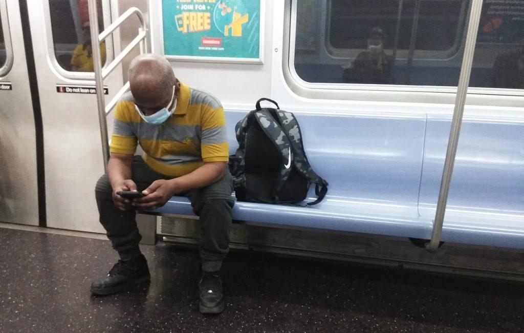 MTA New York City Subway riding wearing a facial mask