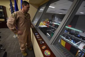 Maj. Gen. B. Chance Saltzman observes airmen clearing out of operations division floor