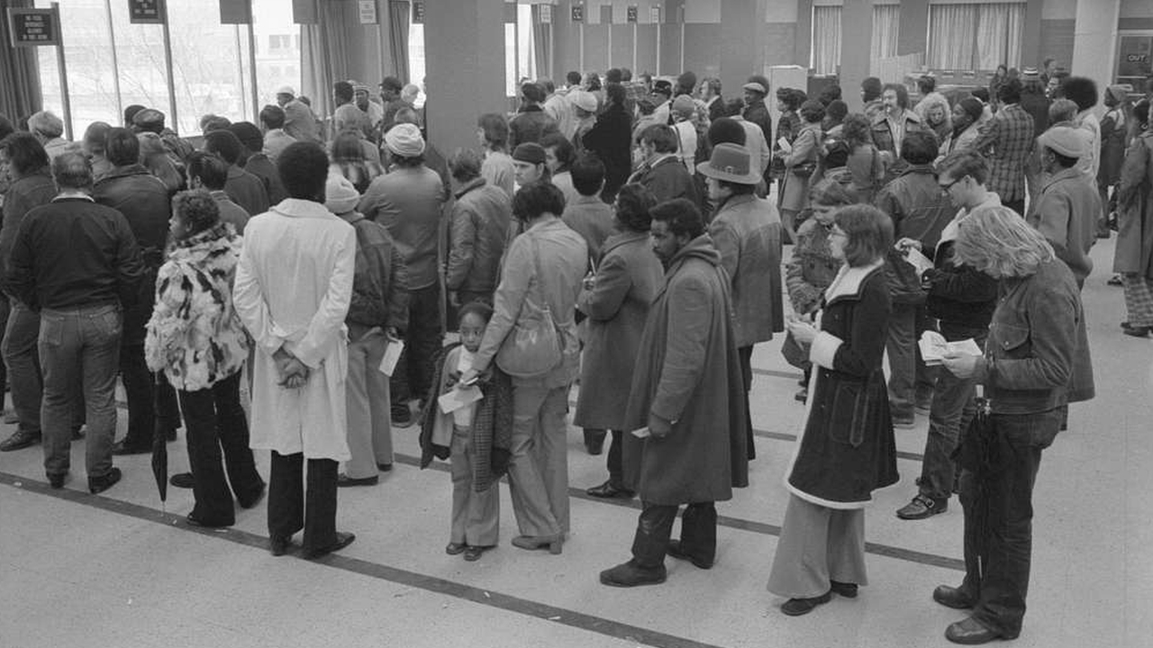 Lines of people at the offices of the Baltimore City Welfare Office, Maryland