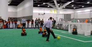 AI100 standing committee chair Peter Stone takes a shot against a robot goalie at RoboCup 2019 in Sydney